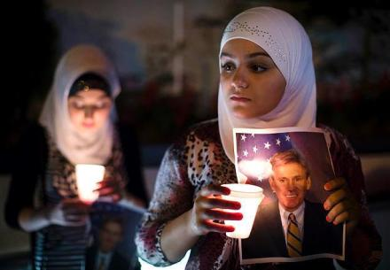 Libyans hold a candle-light vigil for Ambassador Chris Stevens